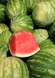 Vertical image of large watermelons, one sliced open to show freshness Stock Image