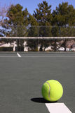 Vertical image of tennis ball on court Stock Photos