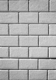 Vertical image of white textured bricks wall. Closeup Stock Photography