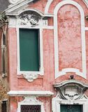 Vertical: Intricate art, sculptures, and ironwork adorn the historic buildings in Venice, Italy. Focus on details of Venetian artistry on display throughout the Stock Images