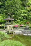 Vertical Japanese outdoor stone lantern in the zen garden Royalty Free Stock Image