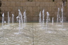 Vertical Jets of water in fountain royalty free stock photography