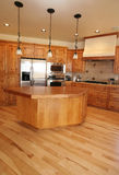 Vertical Kitchen. A new kitchen in a Montana home.   Maple flooring Royalty Free Stock Photos