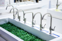 Vertical kitchen tap Royalty Free Stock Image