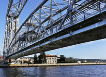 Vertical lift bridge spanning a harbor channel Stock Image