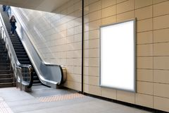 Vertical light box poster mockup in metro station,. High resolution. Ready for your Design stock photo
