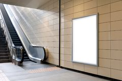 Vertical light box poster mockup in metro station,. High resolution. Ready for your Design stock photography
