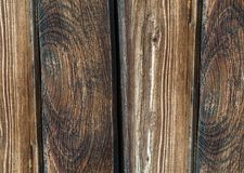Vertical line boards brown wooden surface dark rustic background Royalty Free Stock Images