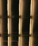 Vertical lines. Neon light ceiling in an airport gate stock images