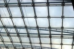 Vertical lines. Steel and glass ceiling in an airport hall royalty free stock images