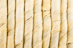 Vertical lines made of straw. Closeup of vertical lines of straw like material royalty free stock photography