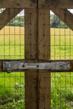 Vertical of locked fence by field Royalty Free Stock Images