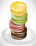 Vertical macaroons on plate Stock Photos