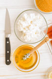 Vertical making bowl of cottage cheese with honey Stock Photo