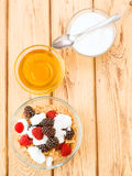 Vertical making breakfast with yogurt and cereals Royalty Free Stock Images