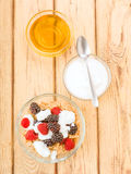 Vertical making breakfast with yogurt and cereals Royalty Free Stock Image