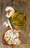 Vertical making fried baby eels with garlic and oil Royalty Free Stock Photography
