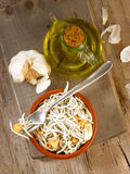 Vertical making fried baby eels with garlic and oil Stock Photo