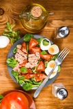 Vertical making homemade Mediterranean salad with olive oil Stock Photography