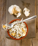 Vertical making mud pie plate with fried baby eels with garlic Royalty Free Stock Images