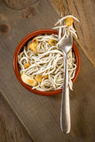 Vertical making mud pie plate with fried baby eels with garlic Royalty Free Stock Image