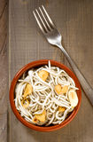 Vertical making mud pie plate with fried baby eels with garlic Royalty Free Stock Photography