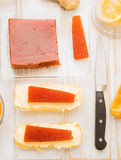 Vertical making quince jelly on butter spread Royalty Free Stock Image