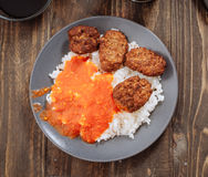 Vertical making rice dish with tomato and meat balls Stock Images