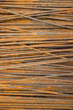 Vertical MCU of thin semi-rusty steel bars stacked in a horizontal position with some diagonal Stock Photo