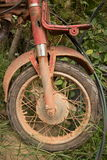 Vertical Medium shot of muddy front fork, wheel, and frame of light motorcycle Royalty Free Stock Photo