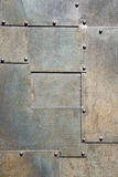 Vertical metal panel door. With bolt stock image