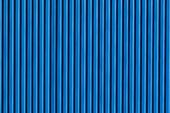 Vertical Metal Sheeting Blue. Picture of a section of the design and detail in the steel alloy sheeting on warehouse building structure Royalty Free Stock Photos