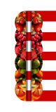 Vertical mirrored semicircles with fruits and bound by ribbons royalty free stock image
