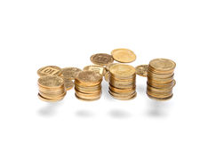 Vertical money stack with scattered coins Stock Photos