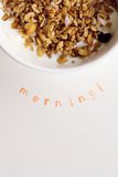 Vertical Morning text stamped under bowl of fresh cereal and mil. K with clear space for text stock image