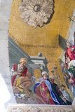 Vertical mosaic detail on St. Mark`s Basilica in Venice. Arabic turbans depicted in detail of mosaic about the transferring of St. Mark`s body to Venice Stock Photo