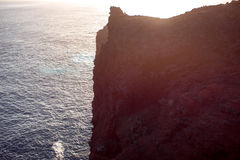 Vertical mountain cliff on the island coast Royalty Free Stock Images