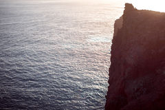 Vertical mountain cliff on the island coast Royalty Free Stock Photo