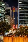 Vertical night view of Sydney tower eye from market street with people in Sydney NSW Australia. 23rd December 2018, Sydney NSW Australia : Vertical night view of royalty free stock images