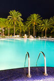 Vertical night view for tropical swimming pool Stock Photo