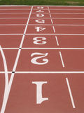 Vertical numbers of athletics track. Royalty Free Stock Images