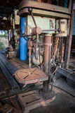 Vertical old drilling machine Stock Photography