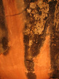 Vertical orange cave wall. Vivid orange and black stained sandstone wall in portrait orientation Stock Photography