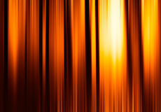Vertical orange motion blur curtains with glow background Royalty Free Stock Images