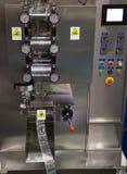 Vertical packing machine. Sauce sachet automatic vertical sealing and packing machine Royalty Free Stock Image