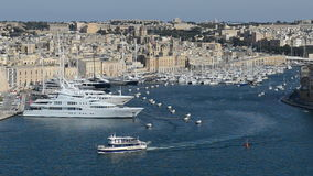 The vertical panning of view on Birgu and yacht marina stock video