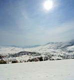 Vertical panorama of idyllic snowy winter landscape in the mountains Stock Image