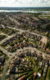 Vertical panoramic aerial view of suburban houses in Ipswich, UK. Orwell bridge and river in the background. stock photos