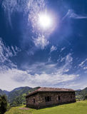 Vertical Panoramic Janjehli valley and multicolor roofed hut. Vertical Panoramic view of Janjehli valley and multicolor roofed hut under a beautiful bright sunny Stock Photo