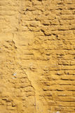 Vertical part of ochre yellow washed wall Royalty Free Stock Photos